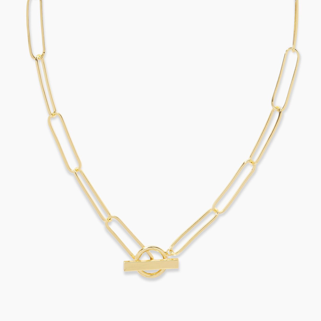 "SUPERSIZE ME: oversized chain links offer maximum impact. Make no mistake. These oversized paperclip chain links are considered a ""statement piece"".  17"" chain 1/2"" diameter ring 13/16"" long bar Toggle closure 18k gold plated brass Avoid contact with anything containing derivatives of alcohol"