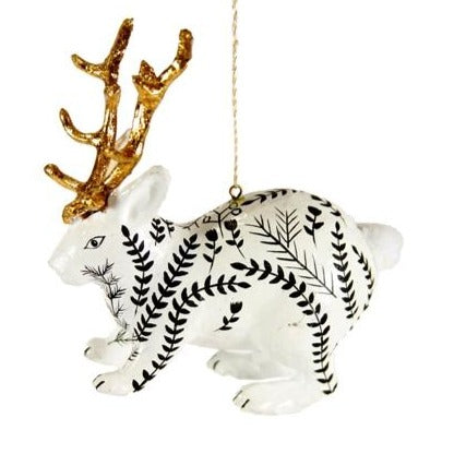 Magic in the Air! Christmas is the time to believe the impossible, which is why this Jackalope with Goldleaf Antlers Christmas Ornament is the perfect thing to hang from your tree. This little mythical creature has gorgeous gilded antlers and is painted with a festive black design, and will inspire magic this holiday season!