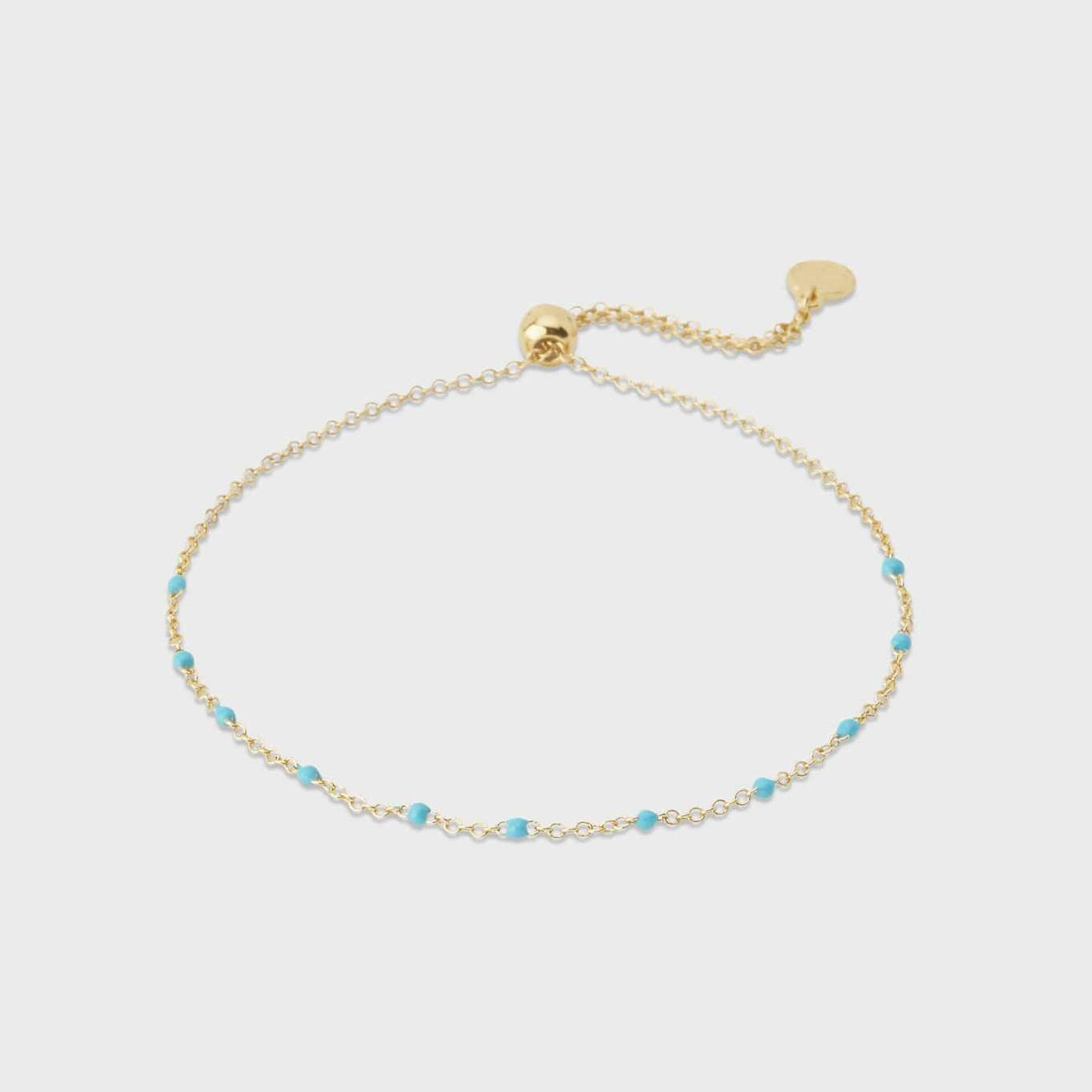"A light splash of color is an ideal addition to your current bracelet stack. This delicate adjustable bracelet features brightly-hued enamel beads.  Bracelet adjusts out to 9"" Slide closure Enamel 18k gold plated brass Avoid contact with anything containing derivatives of alcohol"