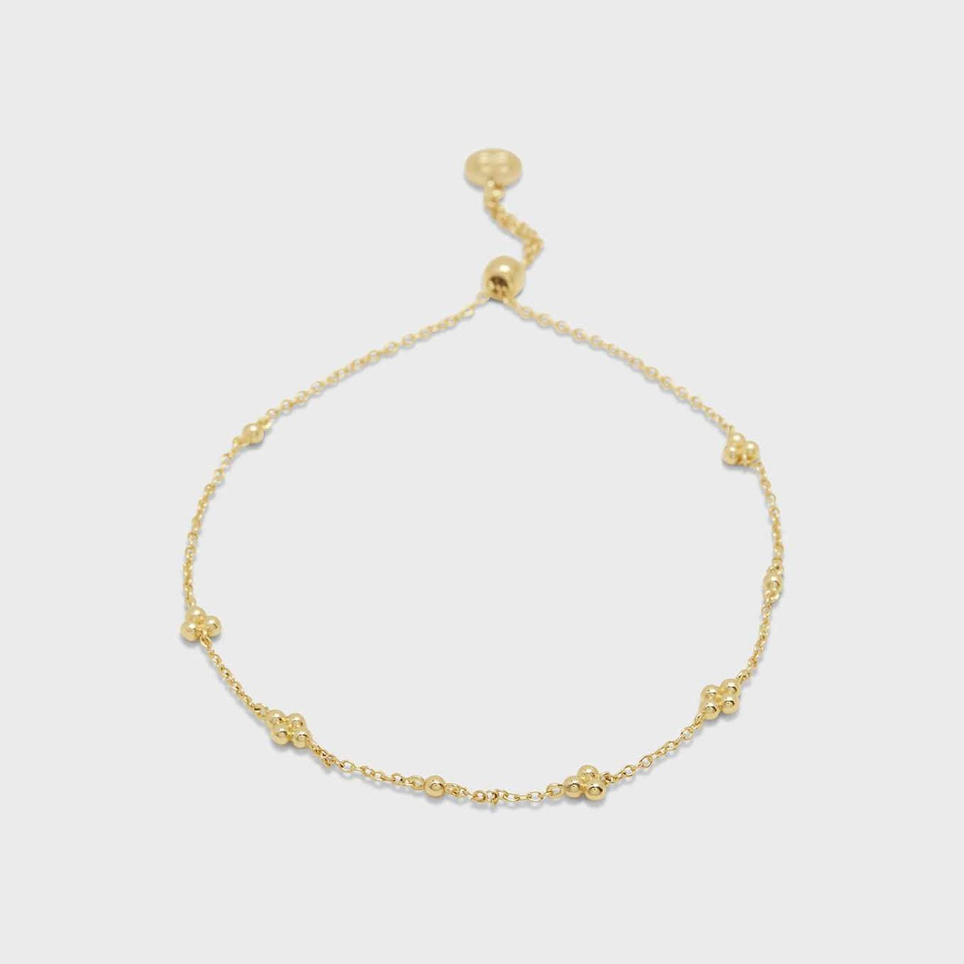 "A sprinkling of gold beads begs to catch the light. This delicate and adjustable style is looking for a home in your current bracelet stack.  Bracelet adjusts out to 9"" Slide closure 18k gold plated brass Avoid contact with anything containing derivatives of alcohol"