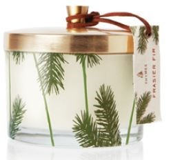 A holiday favorite, dressed up and ready to fill your home with the mountain fresh scent of Frasir Fir. Snow-white wax poured into clear glass, embellished with the classic pine needle design and iconic green hues is truly a glowing focal point with its gold metal lid and hang tag.   Non-metal wick provides a clean burn. 11.5 oz.