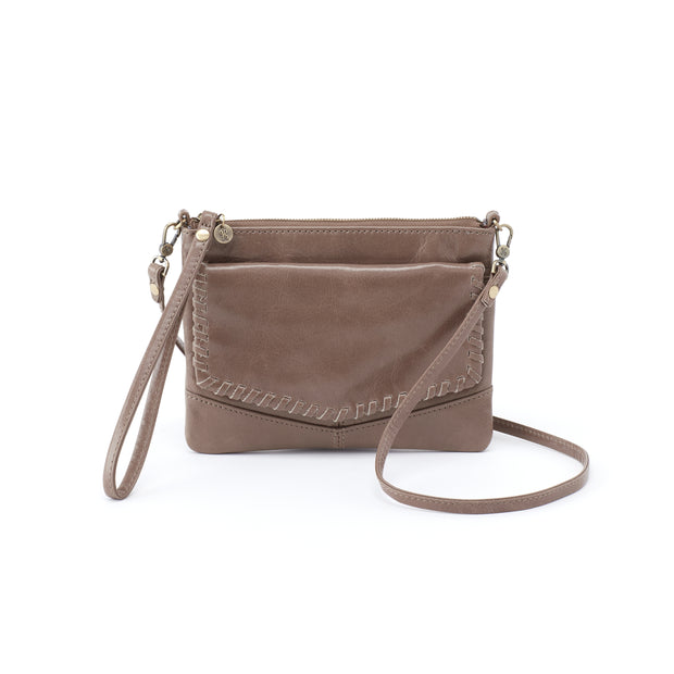 Hobo Stroll in Gravel. The Hobo Stroll - a wristlet and a crossbody all in one! This perfectly sized crossbody converts to a wristlet simply by removing the long crossbody strap. It's sized to fit your phones, ID, cash, and credit cards. Crafted in Hobo's signature vintage hide leather that only gets more beautiful over time with use and wear.