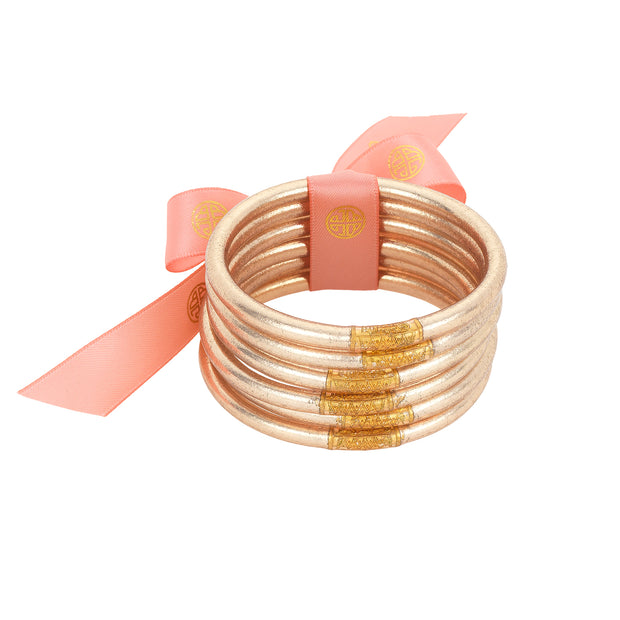 The BuDhaGirl Champagne All Weather Bangles® are here!!! Six orbs filled with divine gold leaf custom blended exclusively for BuDhaGirl. These Champagne AWB® have the same amazing qualities that have made them become the modern woman's go-to jewelry of choice... Set of 6 bangles.