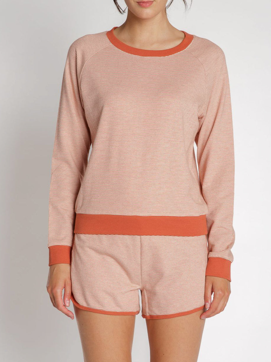 Lounge the day away in this comfy and cozy sweatshirt. Pair it with our Lounge Away Shorts for the perfect on trend coordinate loungewear set. Girls this is your lazy day uniform!  Fits true to size.  43% Rayon, 42% Cotton, 15% Polyester Do not tumble dry.