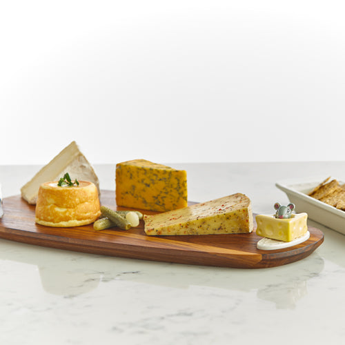 This black walnut tasting board from Nora Fleming is as elegant as it is striking. serve your favorite cheeses and charcuterie on this dazzling piece. With Nora Fleming serving platters and minis you can dress up your dinnerware with interchangeable pieces for everyday serving. Add any Nora Fleming Mini to your favorite Nora Fleming platter or base for easy entertaining and for every occasion!