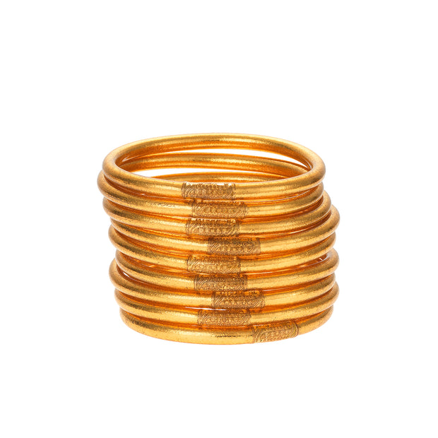 You can wear your All Weather Gold Bangles anywhere without being afraid of tarnish or any kind of sound. These Gold All Weather Bangles are made with gold leaf suspended in flexible, polyvinyl carbonate rings, and then sealed with our exclusive BuDhaGirl Serenity Prayer bead.  Set of 9 bangles