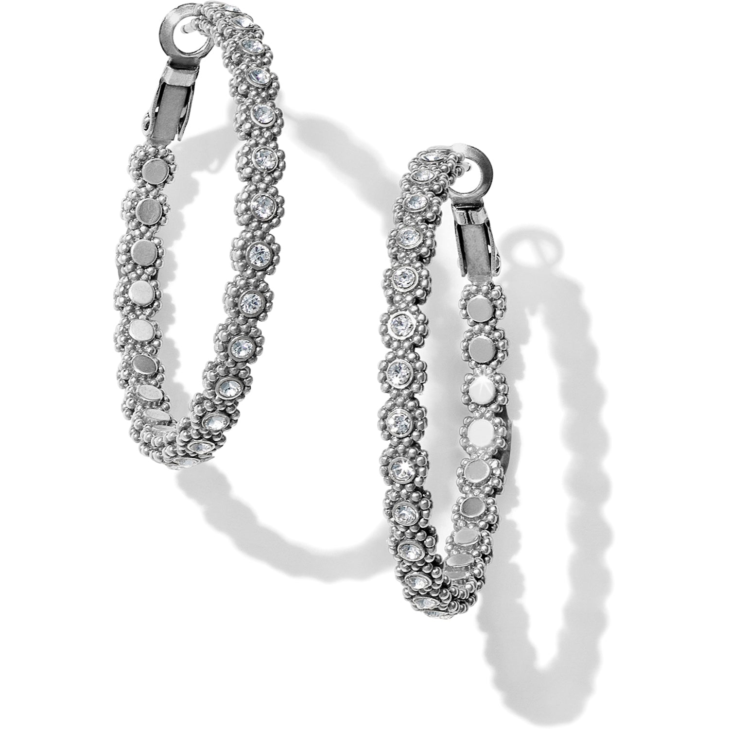 Brighton Twinkle Splendor Medium Hoop Earrings Within a delicately floral motif, crystals outline these medium lacy hoops for an ultra feminine look.