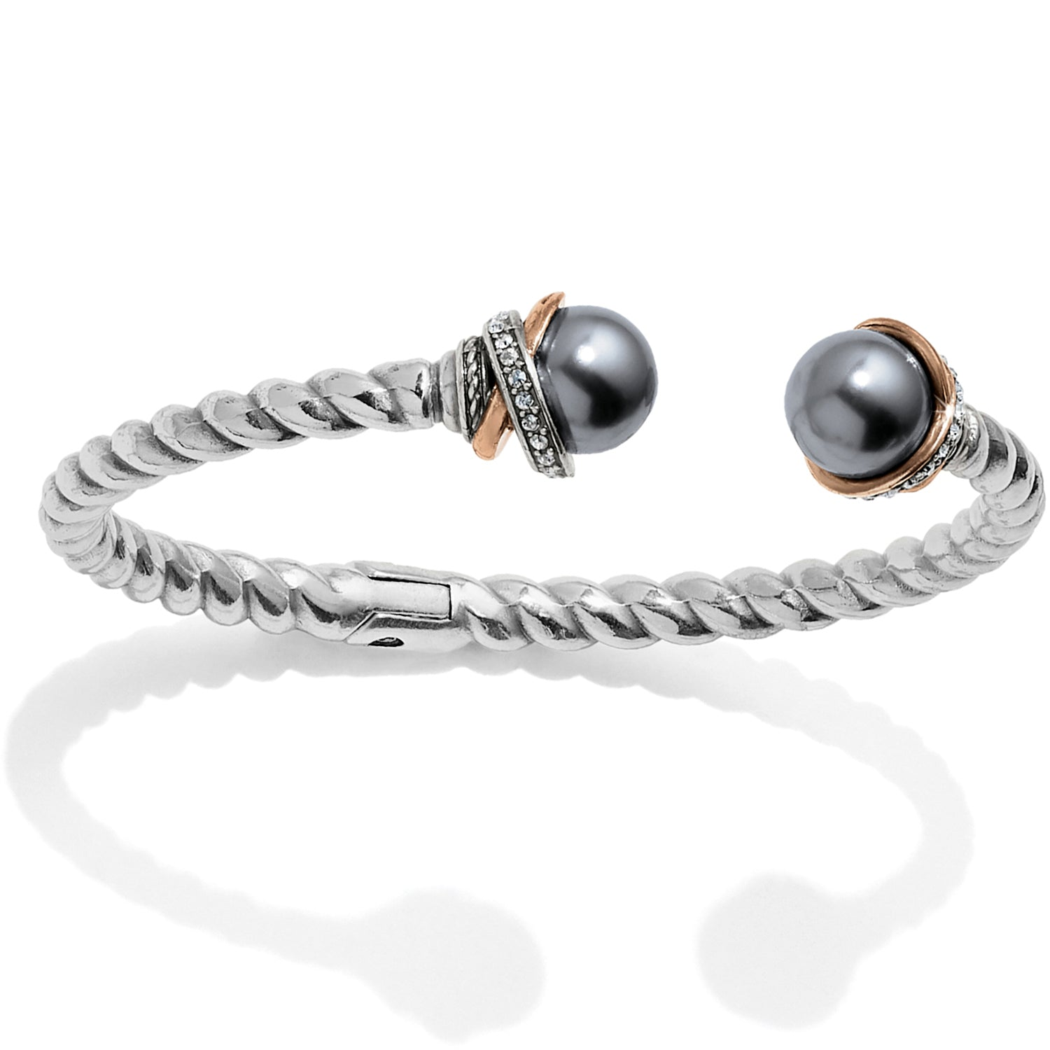 Brighton Jewelry Neptune's Rings Gray Pearl Open Hinged Bracelet. Decadent handmade Japanese gray pearls add luster and luxe to this rope hinged bangle. Finished with a tumble of mixed metal and Swarovski encrusted rings from our Neptune's Rings Collection.