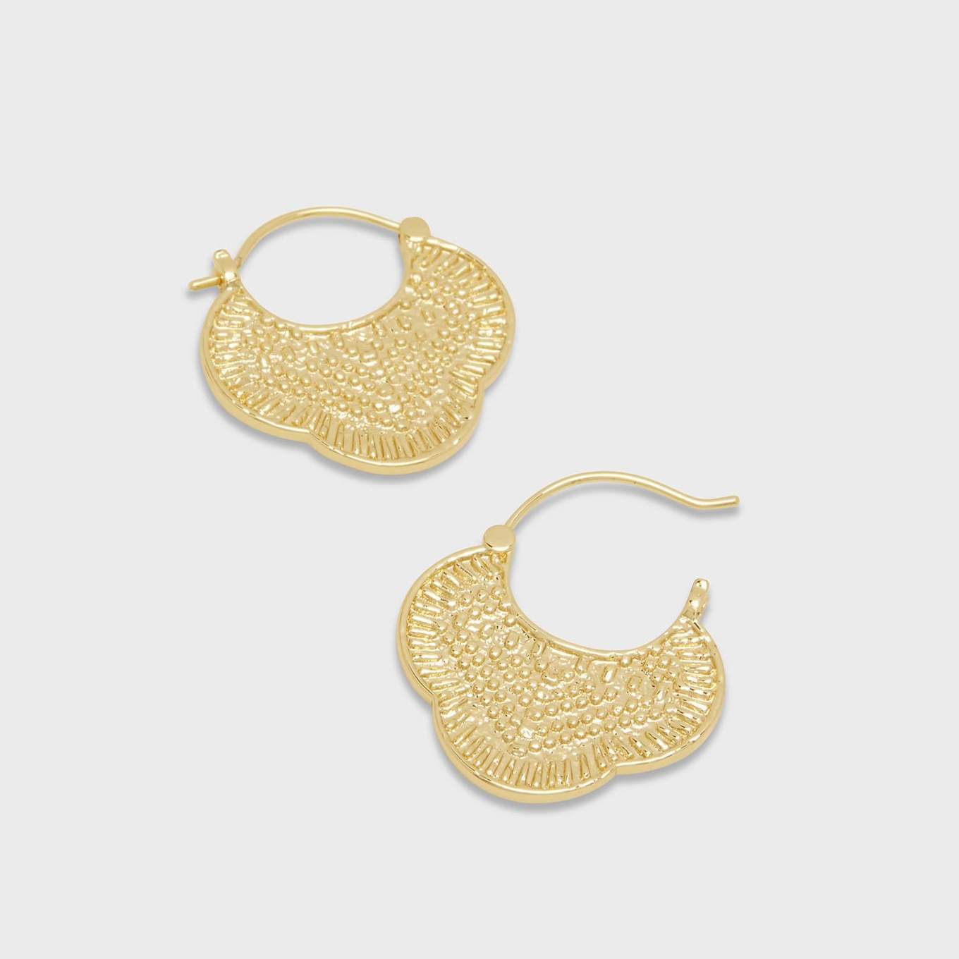 "For those post-beach days when only a topknot will do, show off these golden textured earrings. 15/16"" profile diameter Hinge closure 18k gold plated brass Avoid contact with anything containing derivatives of alcohol"