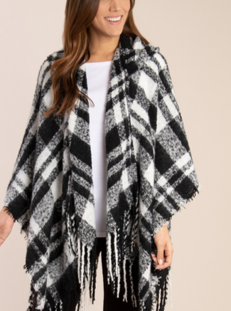 This beautiful Buffalo Plaid Hooded Wrap comes in two colors and is perfect for Fall! This wrap is a great layering piece for those chilly Fall days and easily transitions into the Winter season. Pair this with jeans, leggings, or dresses for a fun look.