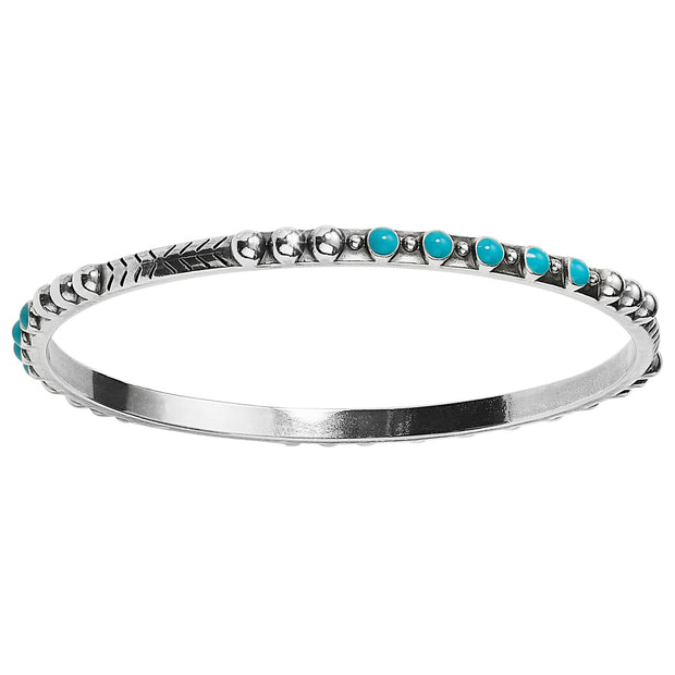 Brighton Southwest Dream Trail Slim Bangle. This slender bangle, dotted with turquoise-hued enamel, lends Southwestern flair to your Boho look. This looks great stacked with your favorite bracelets.
