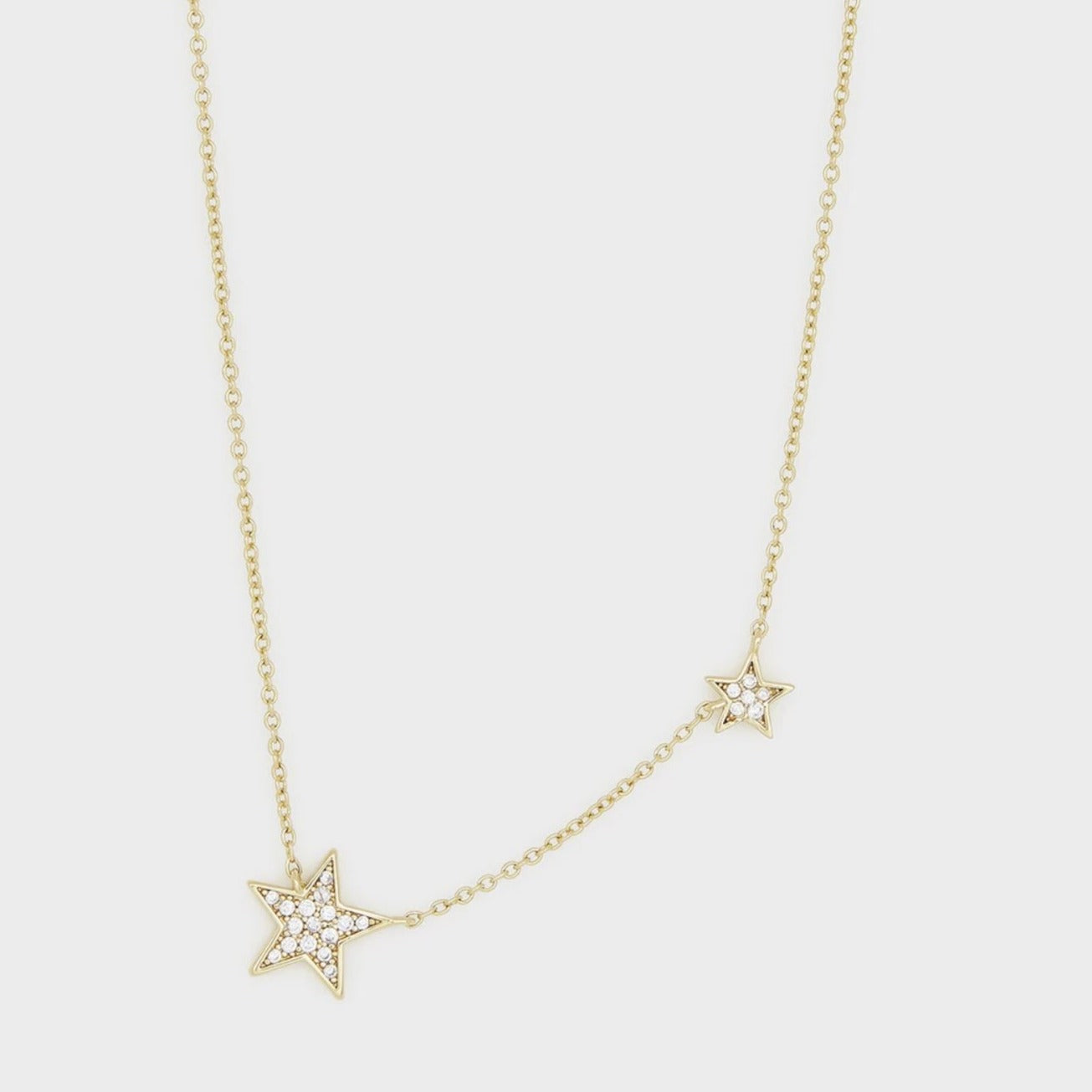 "Inspired by our best-selling Super Star collection. Featuring a duo of pavé encrusted stars, this necklace adds a touch of celestial shine to any outfit. An adjustable slide bead allows this necklace to be worn at multiple lengths.   Adjustable Chain extends out to 17 1/4"" Large star measures 7/16"" across, small star 1/4"" across Spring ring closure with silicone slide bead Cubic zirconia Available in 18k gold plated brass Avoid contact with anything containing derivatives of alcohol"