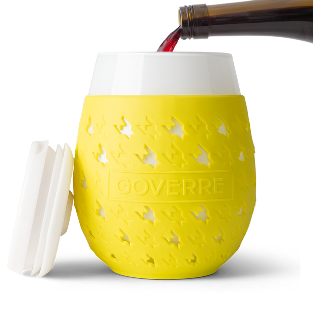 The Goverre Portable Stemless Wine Glass (in Yellow) is perfect for pool side, boats, lake side, beaches and more. It's our go-to outdoor wine glass. Why we love it? It's actually made of glass! The silicone sleeve makes it easy to hold and not slip. And the drink-through lid allows you to be on the go! Holds 17oz.