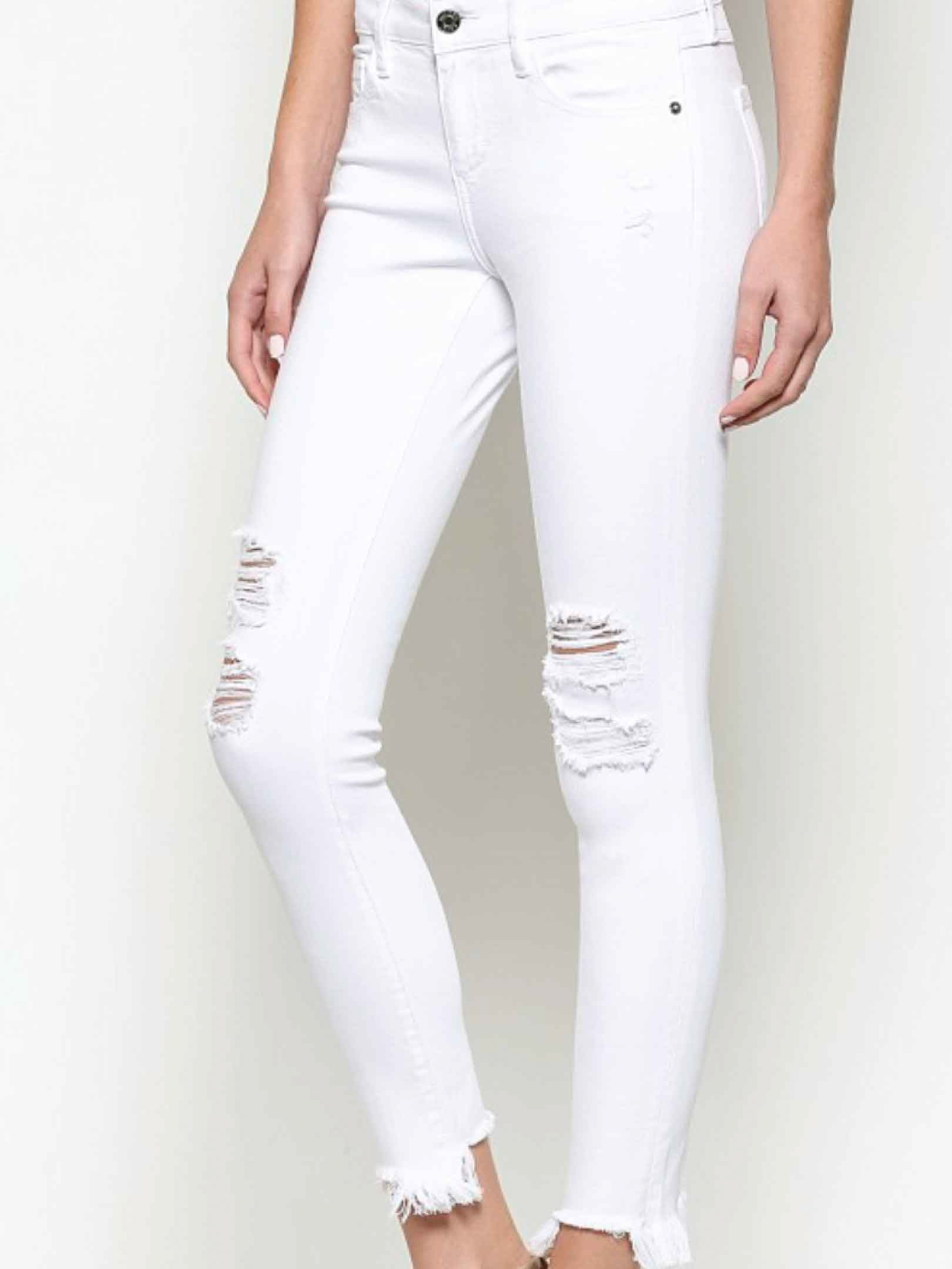 "Always on the lookout for distressed white skinnies? Stop looking! These will be the ones you reach for every time! Girl we don't lie. They are super soft on and stretch perfectly without losing their shape or falling down! Midrise Skinny. Fits true to size. If in between sizes size down. 57% Cotton / 35% Tencel / 6% Poly / 2% Span Rise 8 ¾"" Inseam 27"" Opening 9 ¾"""
