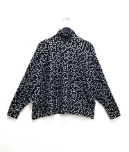 Load image into Gallery viewer, black top with a grey polkadot print. top has long dolman sleeves and a mock turtleneck