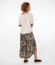 Load image into Gallery viewer, model in a bone colored top with animal print pants and scarf, in front of a white background