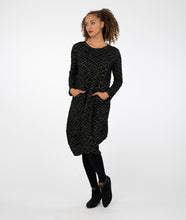 Load image into Gallery viewer, model in black leggings worn with a black dress with a grey geometric print, standing in front of a white background