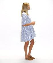 Load image into Gallery viewer, model in a blue and white stripe and dot print shirt dress with a gathered skirt
