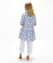 Load image into Gallery viewer, model in a blue and white stripe and dot print shirt dress with a gathered skirt worn over white pants