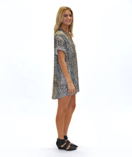 Load image into Gallery viewer, model in a leopard print boxy dress with a v neck and cuffs at the sleeves, in front of a white background