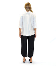 Load image into Gallery viewer, model in a white button down blouse with black pants, in front of a white background