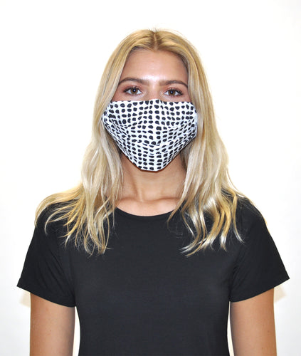 model in a black tshirt with a black and white dot face mask