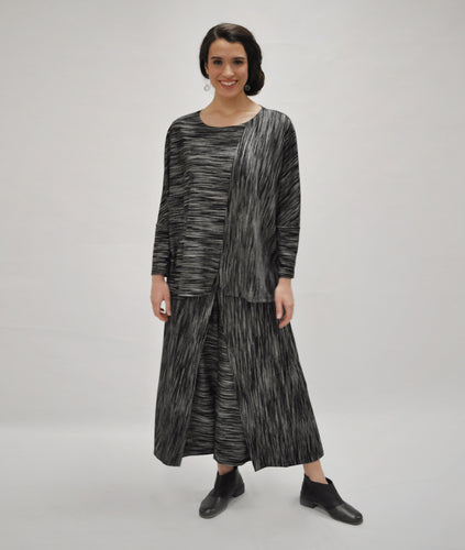 model in a black and grey striped top with a matching wide leg pant
