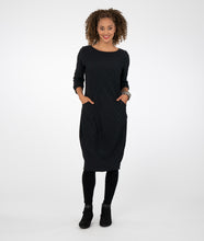 Load image into Gallery viewer, model in a textured black dress with long sleeves