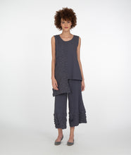 Load image into Gallery viewer, model in a grey textured pant with contrasted hem, worn with a matching sleeveless top with an asymmetrical hem