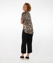Load image into Gallery viewer, model in an animal print top with black pants in front of a white background