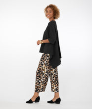 Load image into Gallery viewer, model wearing a black top with animal print pants in front of a white background