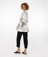Load image into Gallery viewer, model in a white button up top with black and gray print, with black pants in front of a white background