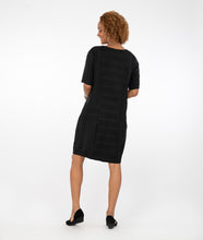 Load image into Gallery viewer, model in a black shift dress with princess seams and pockets at each hip