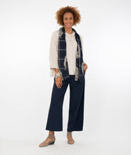 Load image into Gallery viewer, model in a bone color button up top with a blue scarf, navy pants in front of a white background