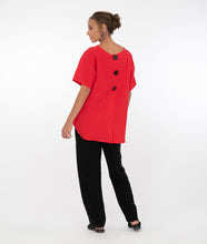 Load image into Gallery viewer, model in a red pull over top with a hi-lo hemline, with black pants in front of a white background