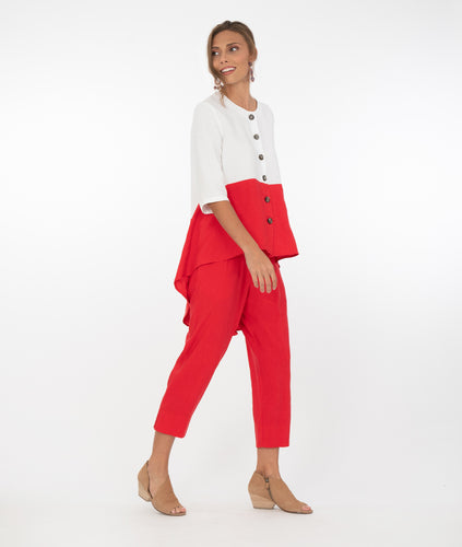 model in a two toned red and white top with cropped red pants in front of a white background