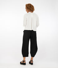 Load image into Gallery viewer, model in a white textured button up top, paired with textured black pants and standing in front of a white background