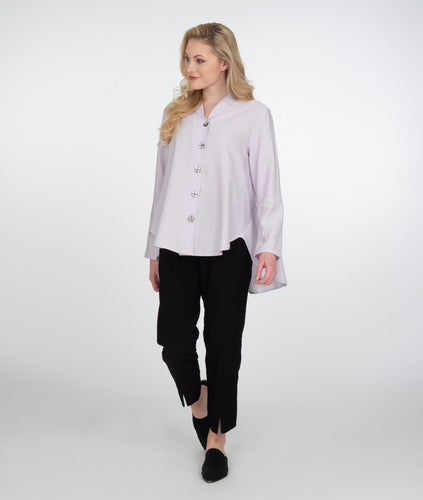 model in a lavendar button up top with black pants with a center seam on each leg with a split at the hem, standing in front of a white background