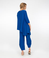 Load image into Gallery viewer, model in electric blue button up top with a matching pant with a tall cuff, in front of a white background