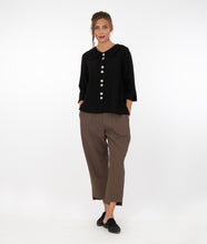 Load image into Gallery viewer, model in brown pants with a black button up jacket