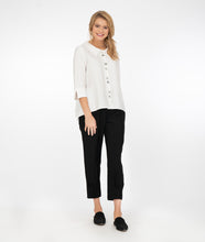 Load image into Gallery viewer, model in black pants with a white button up jacket