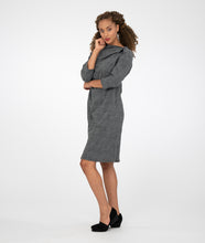 Load image into Gallery viewer, model in a gray dress with an asymmetrical neckline, in front of a white background