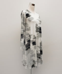 black, white and grey cloud print dress on a mannequin in front of a white background