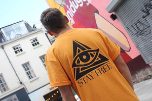 STAY FREE - Orange Crest Logo Tee.
