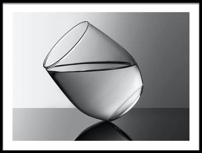 Vossington wall art and fine art photography of a glass of water balancing on a table top