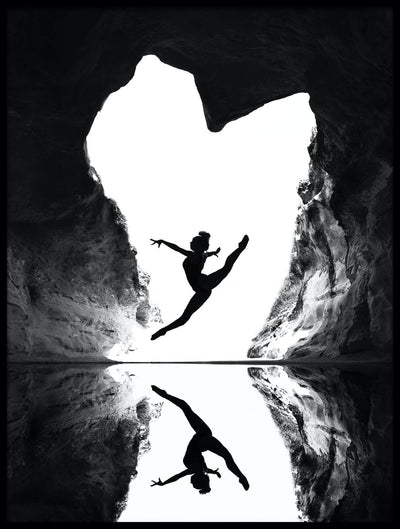 Vossington wall art and fine art photography of a grand jeté ballet jump where the dancer is silhouetted against a heart-shaped entrance to a cave