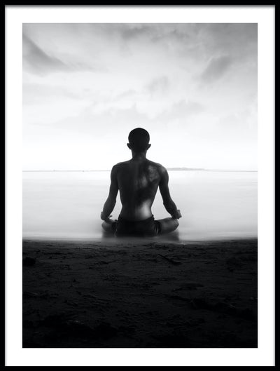 Vossington wall art and fine art photography of an ocean scenery with a man meditating on a beach overlooking a tranquil sea