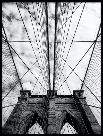 Vossington wall art and fine art photography of the iconic Brooklyn Bridge in New York City against a cloudy sky