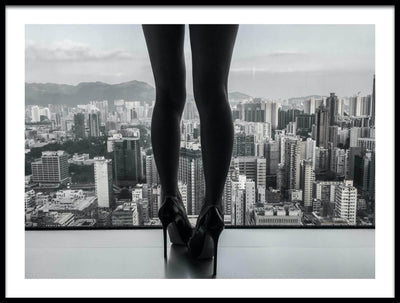 Vossington wall art and fine art photography of high heels and female legs at a window overlooking a city skyline