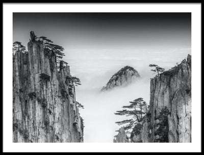 Vossington wall art and fine art photography of mountain peaks sticking up above the white clouds